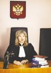 Женщина в судейской мантии